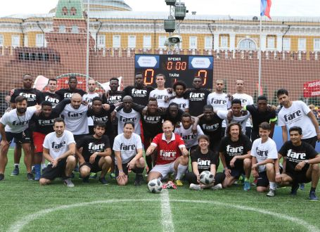 Refugees play on Red Square with a message of inclusion